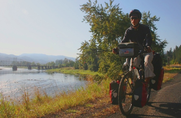 Eric cycling through a remote wilderness area in Idaho along the Locsha River.