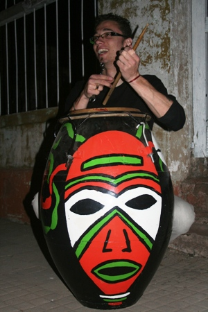 Candombe drummer preparing for Carnival.