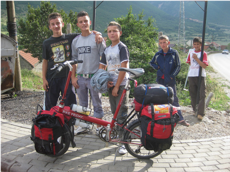 Curious boys eager to pose with the bicycle touring pro's bike.