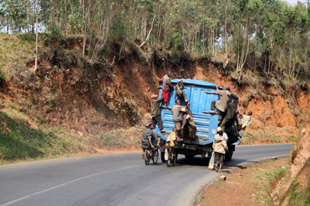 Lorry surfing in Burundi.  Lot's of fun, but you've really got to hold on tight.