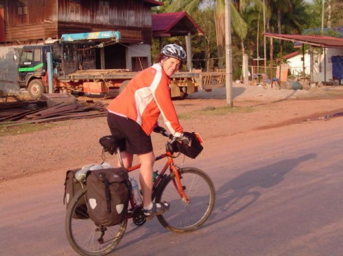 Anna Helmer cycling in Laos (Touring Talk: trading in your backpack for a bicycle)