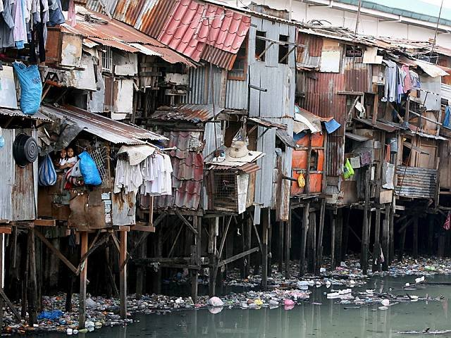 This is the sad reality for 20 million Filipinos who live in slums like this. (photo via BBC)