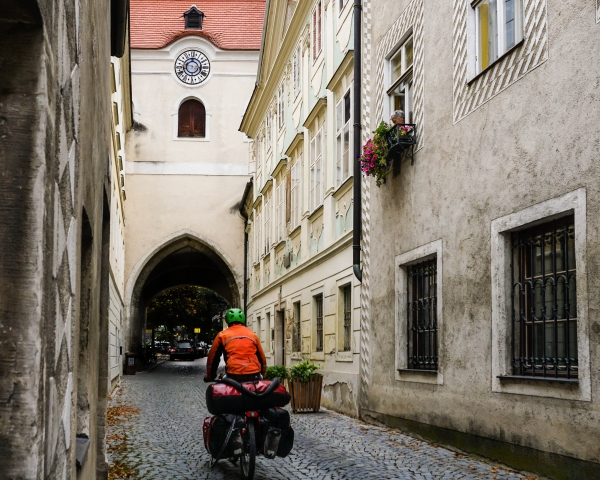 cycling in village with cobbled streets
