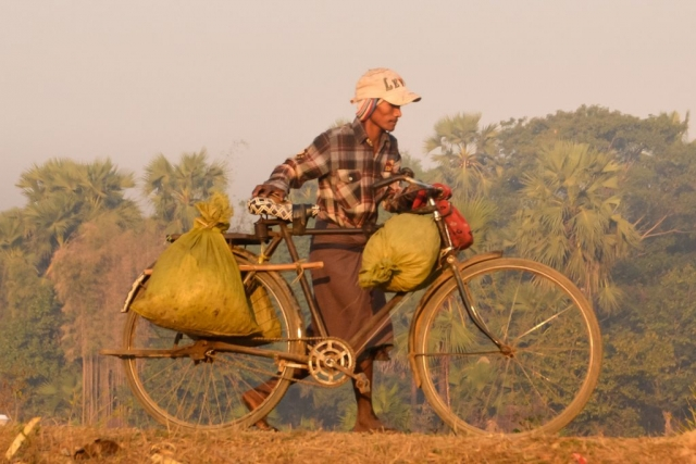 Man with bicycle in Myanmar