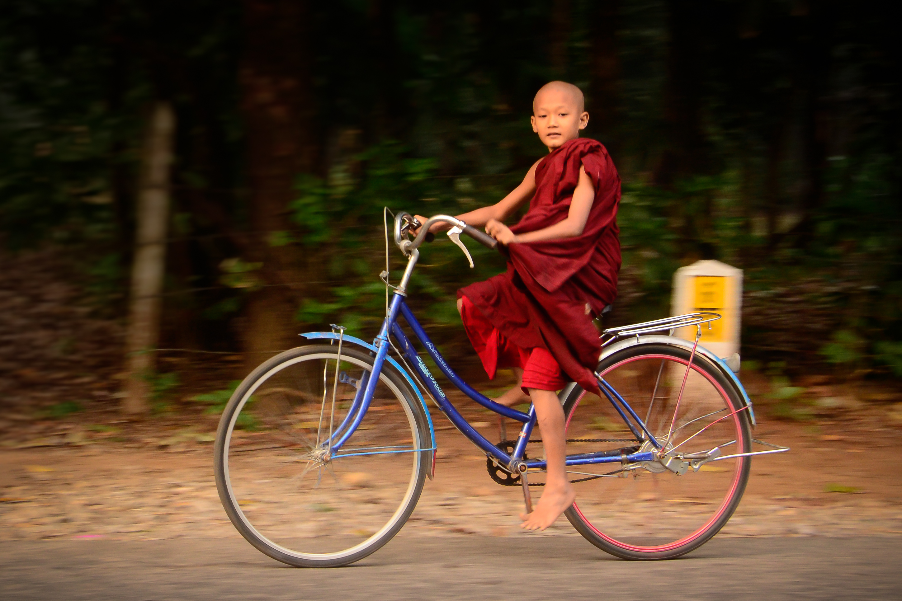 monk on a bicycle in Myanmar