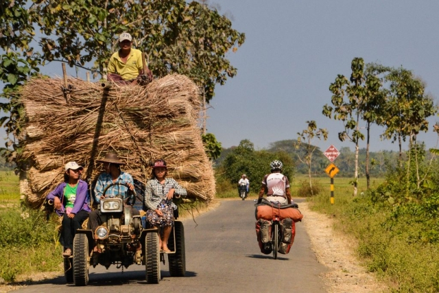 tractor and cyclist in Myanmar