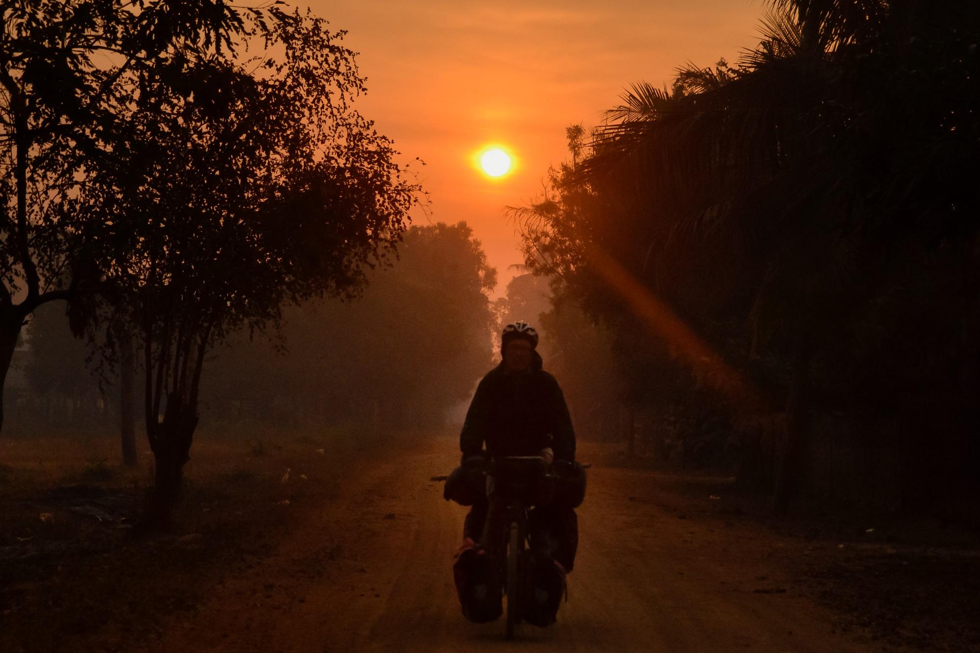 cyclist in sunrise