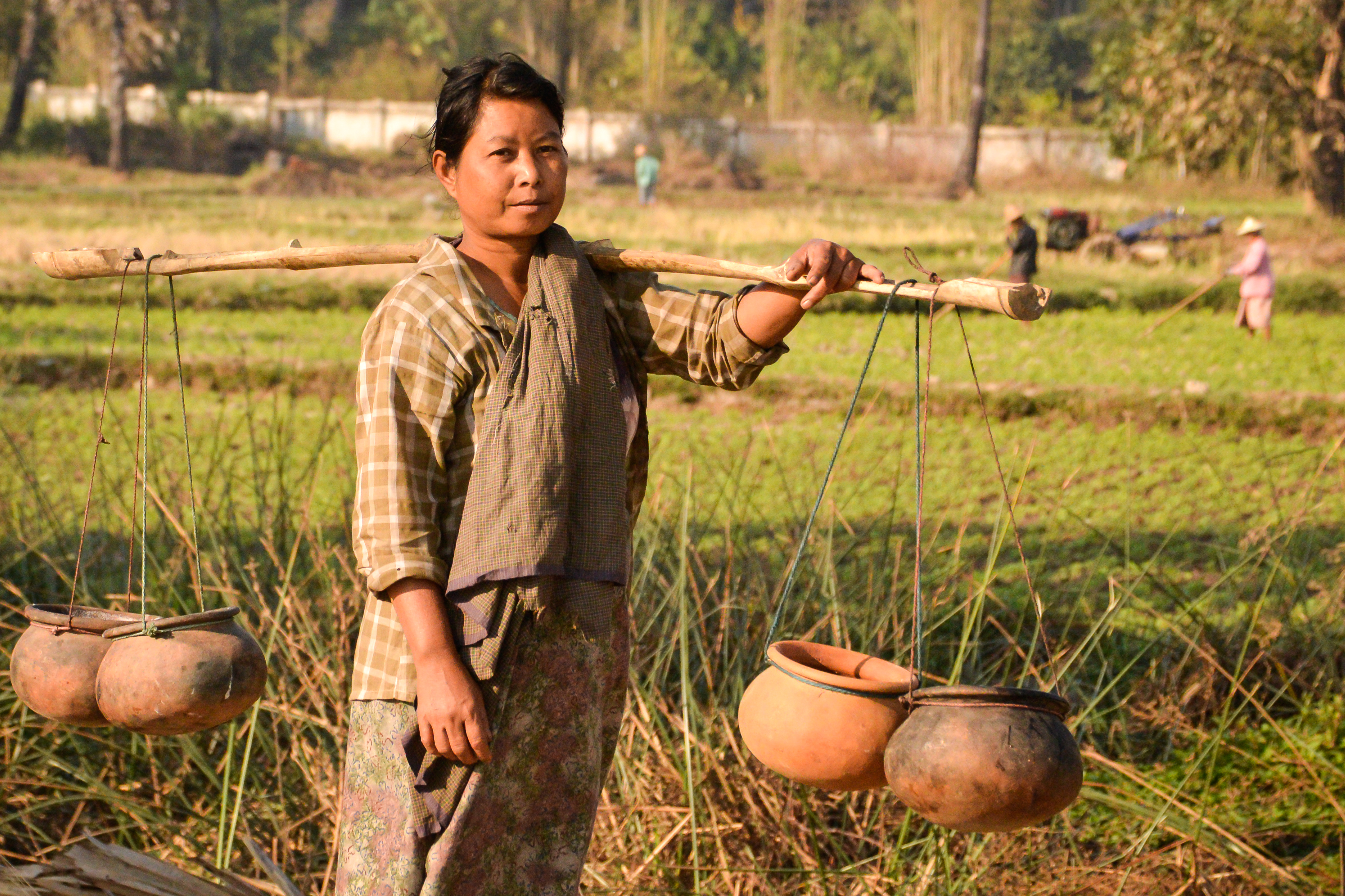 woman fetching water in southeast asia